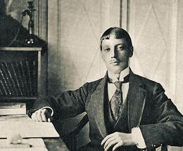 Николай Гумилев в своем кабинете